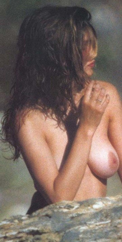 1. Laetitia Casta – Topless sunbathing, 2000