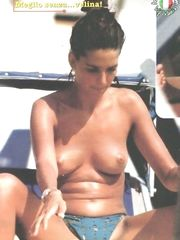 Alessia Merz – Topless sunbathing, 1999