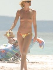 Elle Macpherson – topless at the beach, 2005
