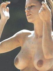 Michelle Hunziker – Topless sunbathing, 1999