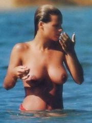 Michelle Hunziker – Topless swimming, 1997