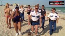 9. Irina Voronina Topless on Beach – Reno 911!: Miami