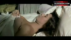 Corinne Clery Covers Naked Breasts – Moonraker