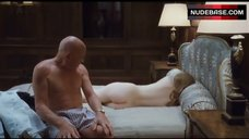 3. Emily Browning Lying Nude on Bed – Sleeping Beauty