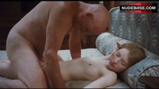 Emily Browning Lying Nude on Bed – Sleeping Beauty