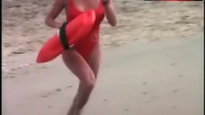 Pamela Anderson Rans in Swimsuit – Baywatch