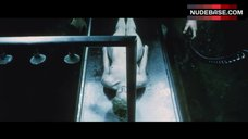 Catherine Sutherland Lying Nude on Table – The Cell