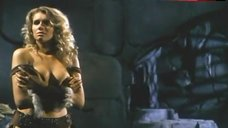 10. Lana Clarkson Shows Breasts – Barbarian Queen