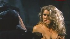 4. Lana Clarkson Shows Breasts – Barbarian Queen