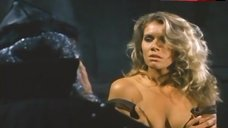 5. Lana Clarkson Shows Breasts – Barbarian Queen