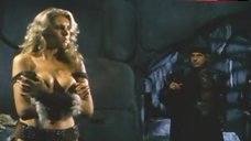 8. Lana Clarkson Shows Breasts – Barbarian Queen