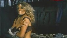 9. Lana Clarkson Shows Breasts – Barbarian Queen