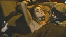 10. Lana Clarkson Topless in Thong – Barbarian Queen