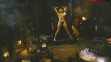 3. Lana Clarkson Topless in Thong – Barbarian Queen