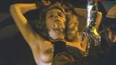 5. Lana Clarkson Topless in Thong – Barbarian Queen