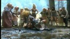 4. Lana Clarkson Topless Fight in Mud – Barbarian Queen Ii
