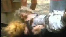 5. Lana Clarkson Topless Fight in Mud – Barbarian Queen Ii