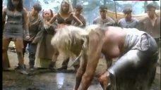 8. Lana Clarkson Topless Fight in Mud – Barbarian Queen Ii