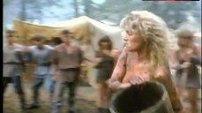 9. Lana Clarkson Topless Fight in Mud – Barbarian Queen Ii