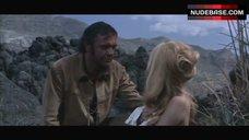 6. Brigitte Bardot Covers Nude Breasts – Shalako
