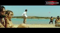 Elli Tringou Topless on Beach – Suntan
