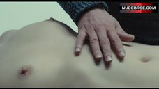 Isild Le Besco Lying Nude on Table – The New Girlfriend