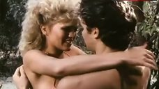4. Amber Lynn Flashes Breasts – Evils Of The Night