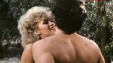 8. Amber Lynn Flashes Breasts – Evils Of The Night
