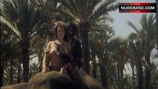 9. Analia Ivars Breasts Scene – Golden Temple Amazons