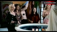 Alicia Witt Without Bra – Four Rooms