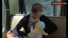 6. Brigitte Fossey Breast Feeding – Going Places