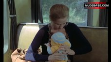 7. Brigitte Fossey Breast Feeding – Going Places